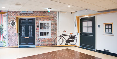 """Advies en implementatie van een """"eigen huis"""" en """"eigen straat"""" voor bewoners met dementie."""